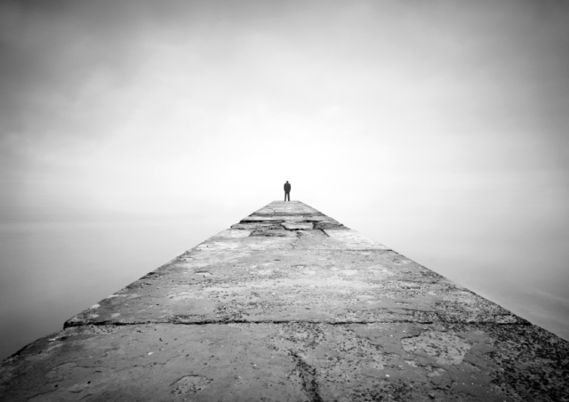 Man on the edge of pier